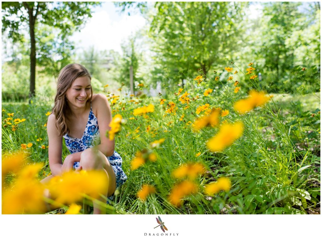Senior photo in a field of flowers