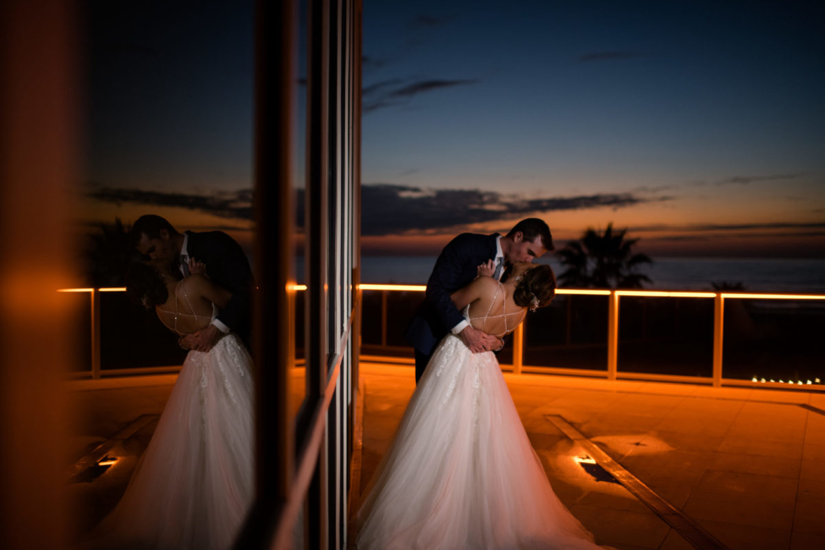 Dramatic Sunset Photo of Bride and Groom