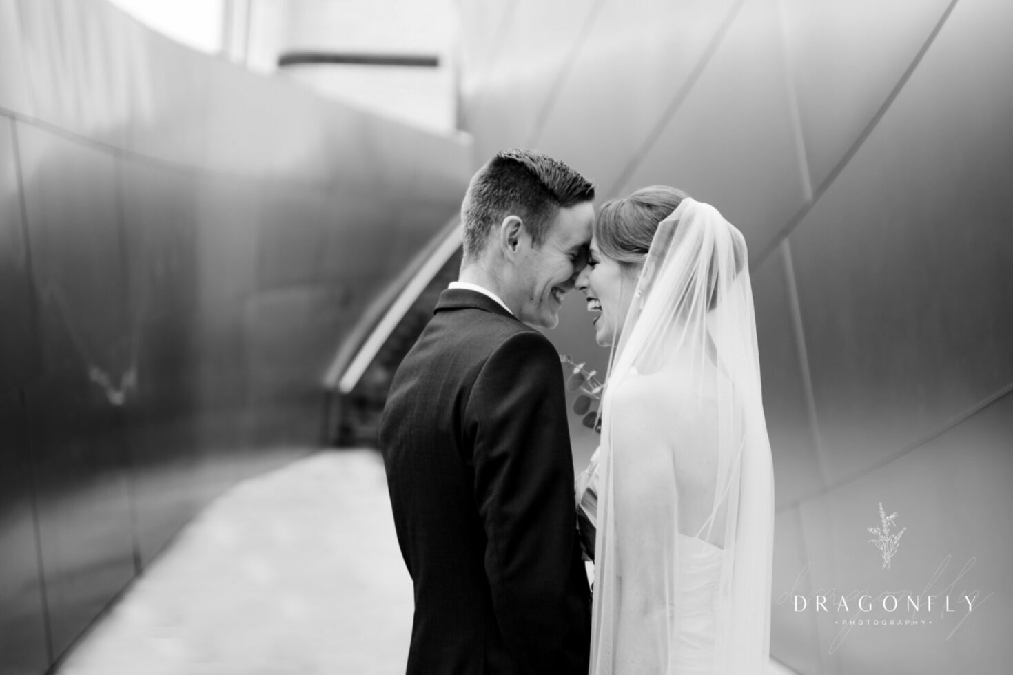 Black and White bride and groom laughing photo