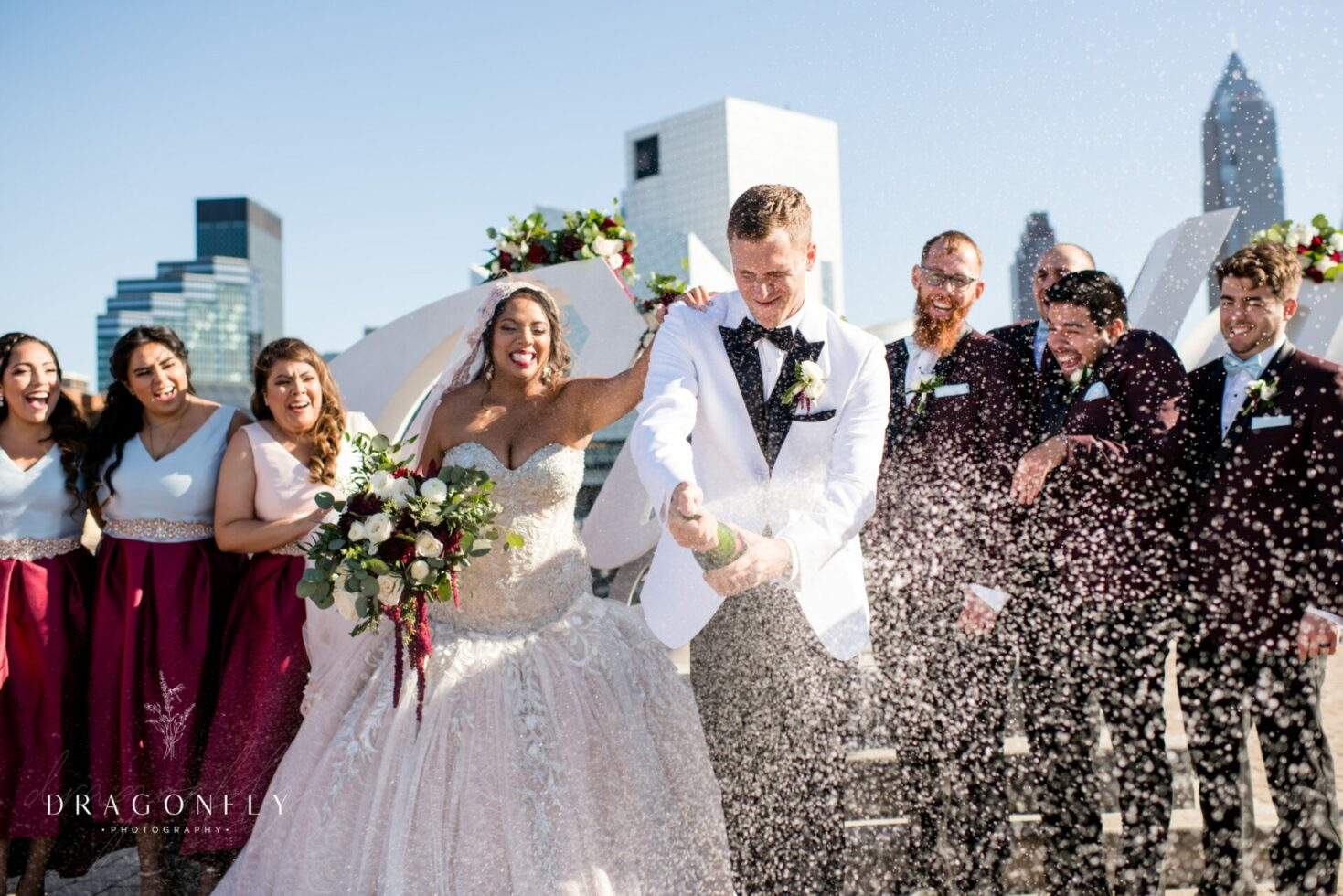 Bride and Groom spray champagne rock hall cleveland ohio