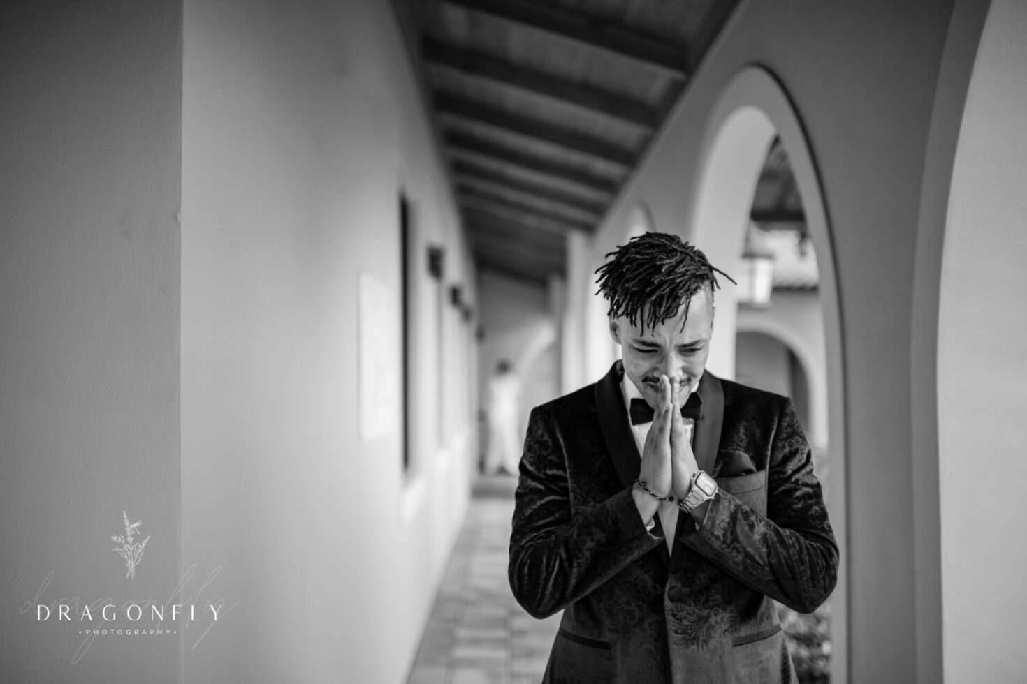 Black and white photo of emotional groom first look