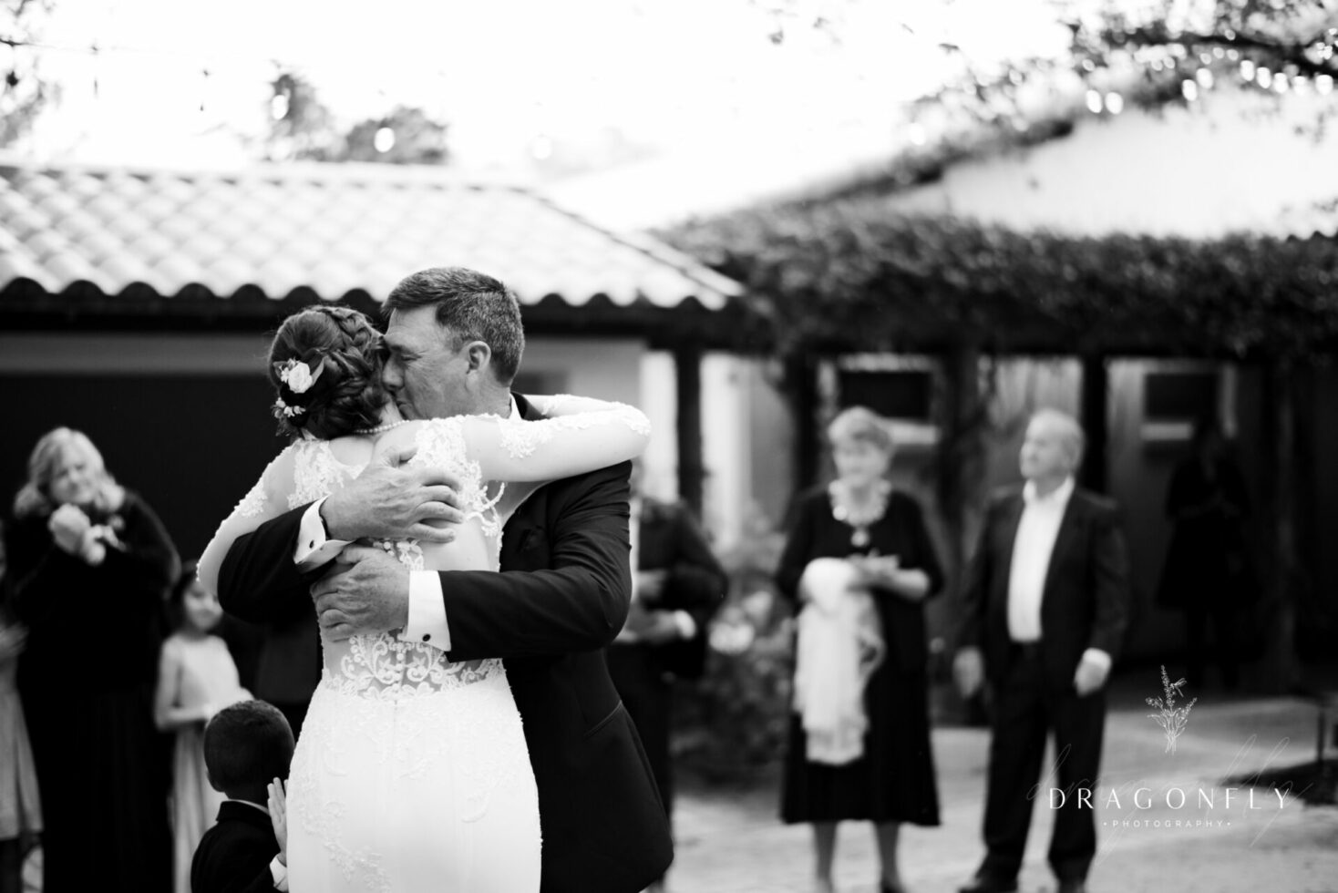 emotional dad hugging bride