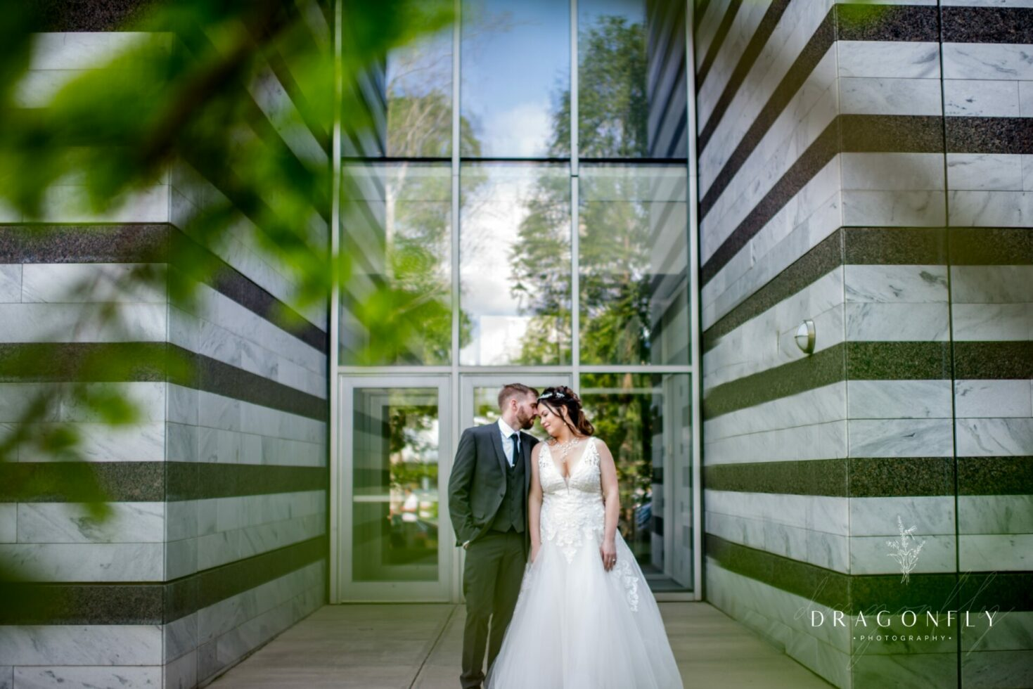 Couple through trees at Cleveland Museum of Art wedding