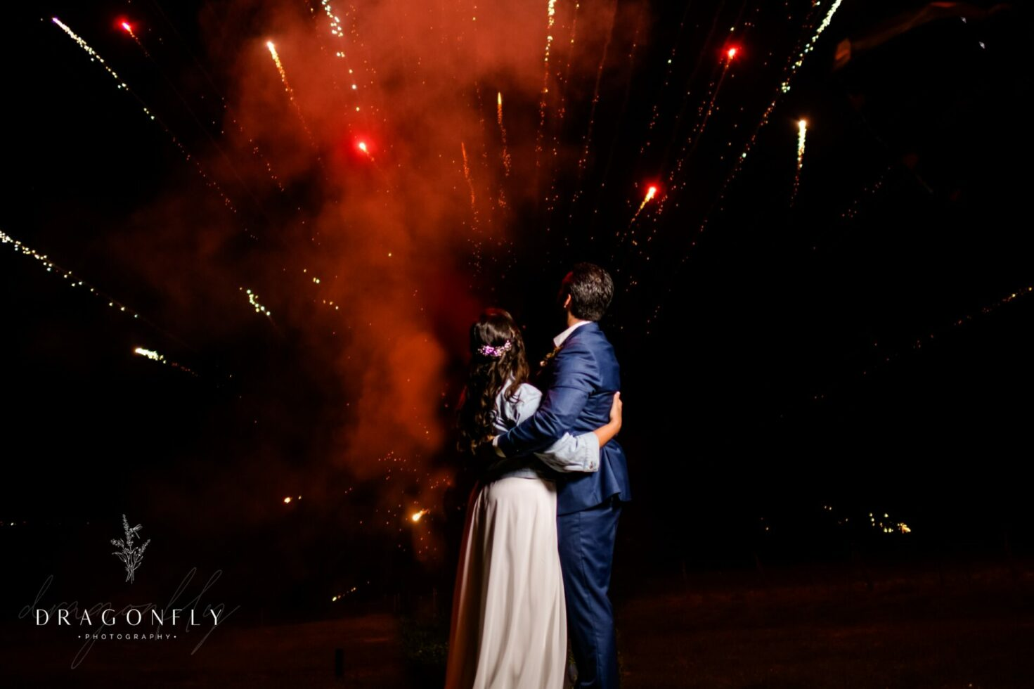 bride and groom watching fireworks rural society