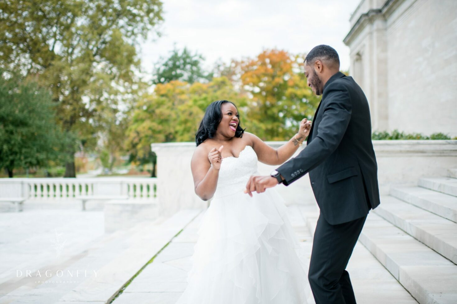 bride and groom dancing on cleveland museum of art steps