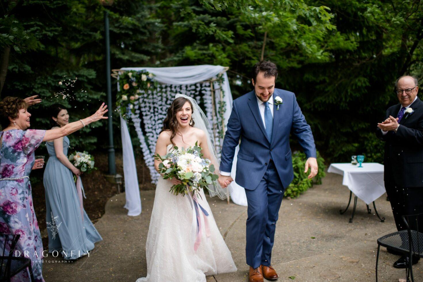 couple exiting wedding at clifton barn avon