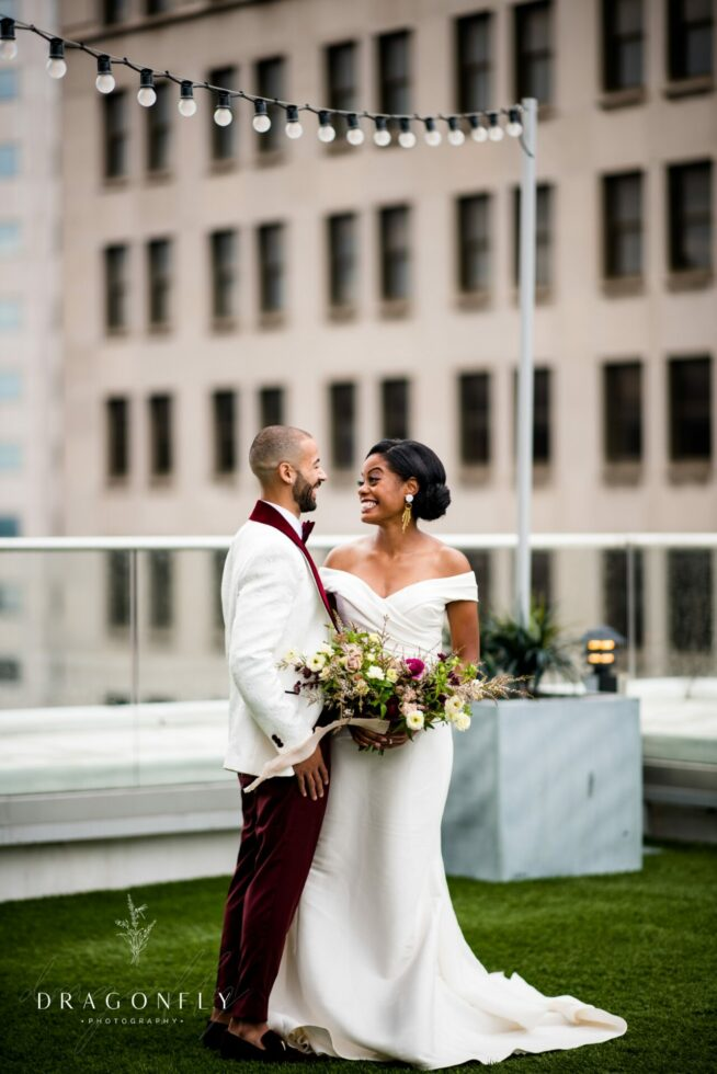 Bride and groom laughing on Rooftop at Metropolitan at the 9