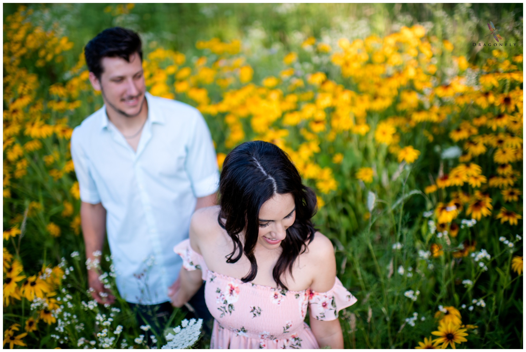 Summer Engagement Photo in Field of Flowers